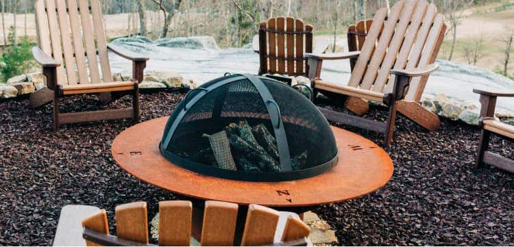 Fire pit with a metal screen cover