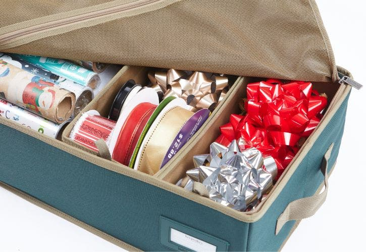 Gift wrap storage bag designed to fit multiple rolls of wrapping paper and decorations