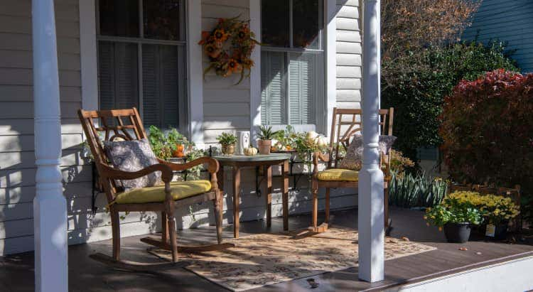 Porch with two chairs and many plants