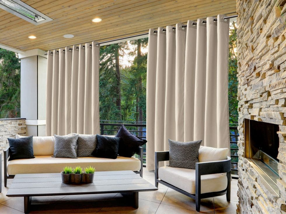 Outdoor curtains hung across a large space