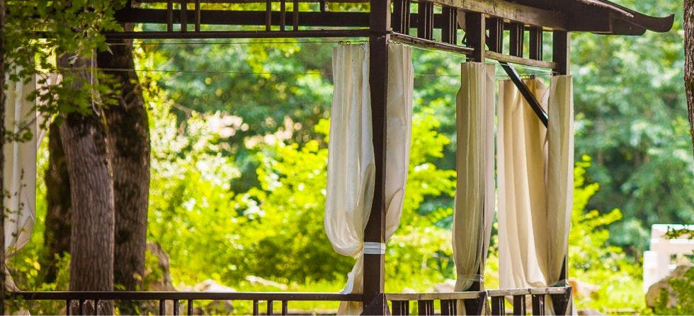 Outdoor curtains hung using wire