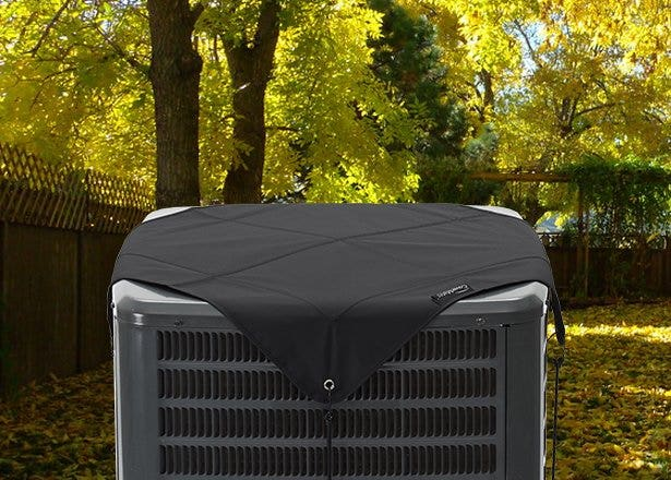 Outdoor air conditioner protected from fall and winter weather with a high-quality cover