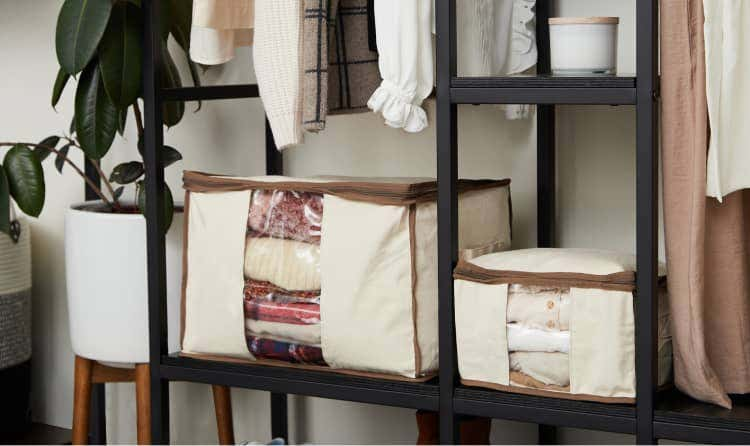 Canvas storage bags with blankets and sweaters inside