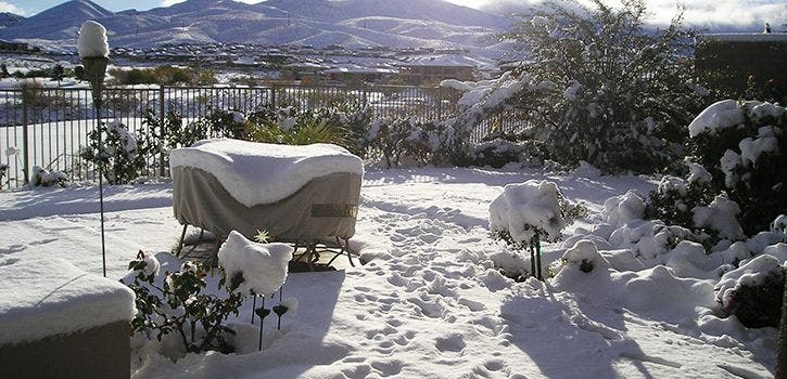 Patio furniture cover from Coverstore protecting outdoor furniture from snow.