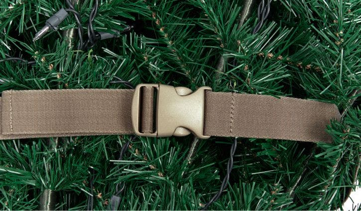 A cinch strap keeping the branches of an artificial Christmas tree together