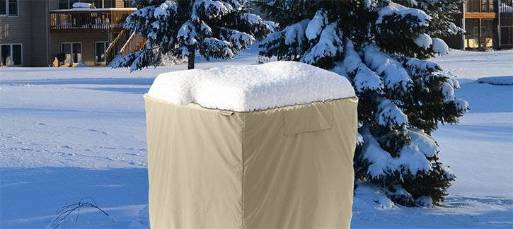 AC cover protecting an air conditioner from snow