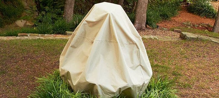 Garden fountain protected by a Coverstore cover